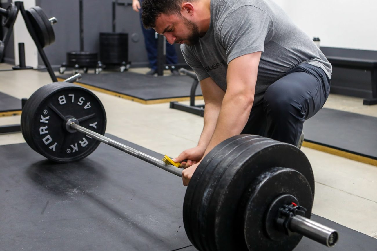 cleaning the barbell